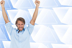 Happy man celebrating success with arms up Stock Photos