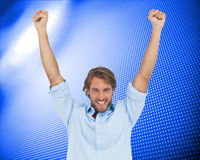 Happy man celebrating success with arms up Stock Images