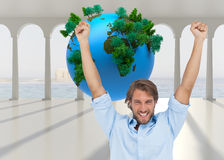 Happy man celebrating success with arms up Stock Photography