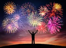 Happy man on celebration background with colorful firework. Anniversary, festival, party and holidays abstract concepts. stock images