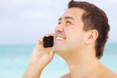 Happy man with cell phone Stock Photos