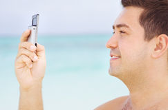 Happy man with cell phone Stock Image