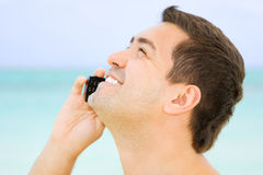 Happy man with cell phone Royalty Free Stock Image
