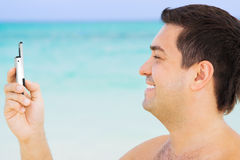 Happy man with cell phone Royalty Free Stock Photos