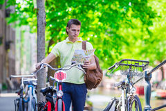 Happy man with a city map and backpack in Europe Stock Photography