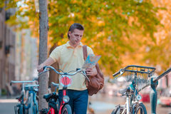 Happy man with a city map and backpack in Europe Stock Image