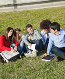 Happy Man With Classmates Sitting At College Stock Photography