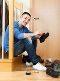 Happy man  cleaning footwear Royalty Free Stock Images