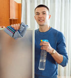 Happy man cleaning  glass  at home Stock Photos