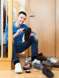 Happy man cleaning shoes Royalty Free Stock Photo