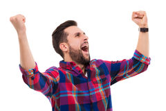 Happy man clenching fists. Young man over white background Stock Photos