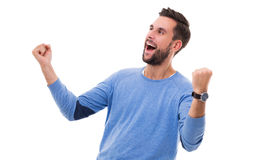 Happy man clenching fists. Young man over white background Stock Images