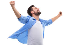 Happy man clenching fists. Young man over white background Stock Photography