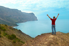 Happy man on the cliff Royalty Free Stock Photo
