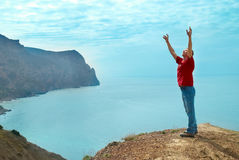 Happy man on the cliff Stock Photos