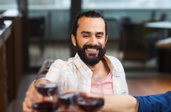 Happy man clinking glass of wine at restaurant royalty free stock photo