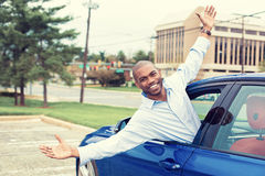 Happy man coming out of a car's window Stock Photo