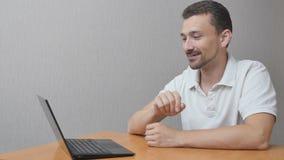 Happy man communicates online stock footage