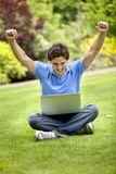 Happy man with a computer Stock Images