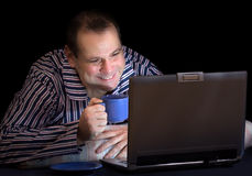 Happy man with computer Stock Image