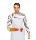 Happy man or cook with baking and kitchenware Stock Photos