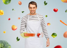 Happy man or cook with baking and kitchenware Royalty Free Stock Image