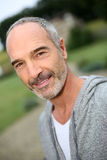 Happy man in countryside looking at camera Royalty Free Stock Images