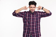 Happy man covering his ears with fingers royalty free stock photo