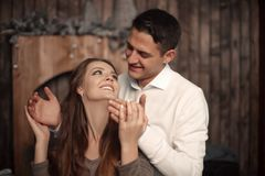 Happy Man covering woman`s eyes with his hands. Surprised girl i royalty free stock images