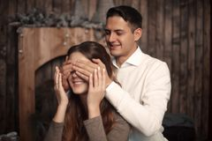 Happy Man covering woman`s eyes with his hands. Surprised girl i royalty free stock photos