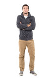Happy man with crossed arms wearing gray zip sweater and ochre pants. Full body length portrait isolated over white background Royalty Free Stock Photos