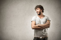 Happy man crossing his arms Royalty Free Stock Photography