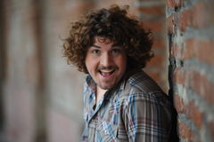 Happy man with curly hair Stock Images