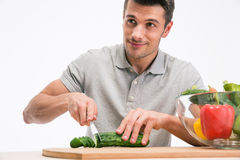 Happy man cutting cucumber Royalty Free Stock Photo