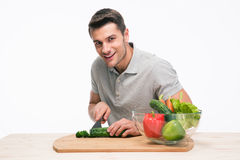 Happy man cutting vegetables Stock Photos