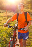 Happy Man Cyclist with Bicycle Walk Stock Photography