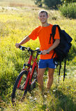 Happy man cyclist among the green scenery Stock Images