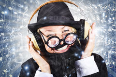 Happy nightclub man dancing at silent disco party Royalty Free Stock Photos