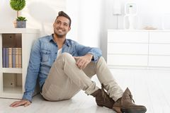 Happy man daydreaming at home Stock Photos