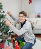 Happy Man Decorating Christmas Tree Royalty Free Stock Photo