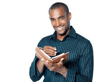 Happy man with diary Royalty Free Stock Image