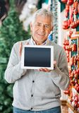 Happy Man Displaying Digital Tablet In Christmas Royalty Free Stock Photo