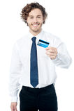 Happy man displaying his cash card Stock Image