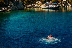Happy man in diving mask swimming in the sea, excursions to the bays of Marmaris. Turkey royalty free stock images