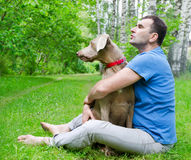 Happy man and his dog stock photos