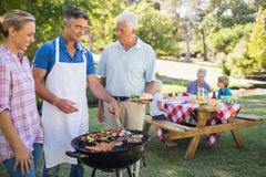 Happy man doing barbecue for his family Royalty Free Stock Images