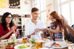 Happy man doing proposal to woman at restaurant Royalty Free Stock Image