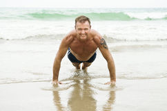 Happy man doing push ups. Royalty Free Stock Image