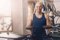 Happy man doing strength exercise dumbbell hands stock photo