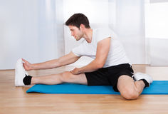 Happy Man Doing Stretching Exercise Stock Photography